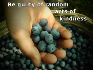 "A hand offering a handful of blueberries with the words ""Be guilty of random acts of kindness."""