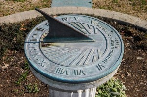 Metal sundial outside.