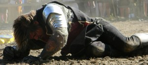 Image of a beaten knight starting to get up after being knocked down.