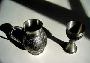 Pewter pitcher and goblet.