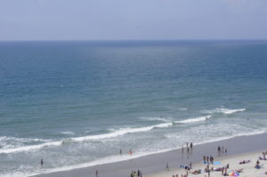 The vast Atlantic Ocean and a sliver of beach with tiny people.