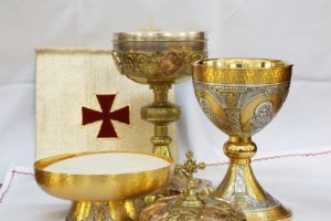 Formal Communion decorated gold cup and wafer container.