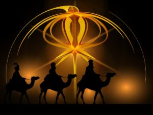 Wonderful artwork of the three kings riding camels, back-lit by a streaming yellow star.