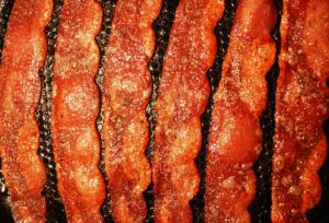 Six slices of bacon crisply cooked.