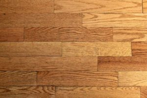 A close-up of a gleaming, polished wood floor.