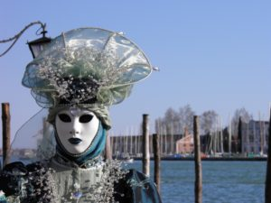 A costumed person during the carnival in Venice, Italy.