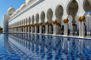 A mosque with a reflecting pool.