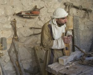 A man posing as a carpenter in ancient Israel.