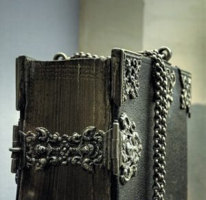Ancient bible, sealed up and surrounded by a chain.