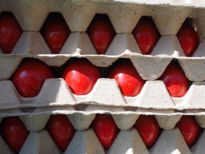 Red eggs stacked in cartons for a Greek Orthodox Easter Service.