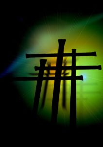 Three stylized crosses against a green background.