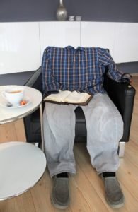 A sign of the Rapture; a man's empty clothes still sitting in a chair.