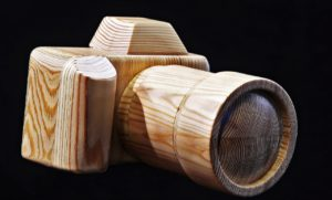 A carved wooden camera.