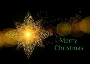 """A stylized golden star and ice crystals with the words, """"Merry Christmas."""""""