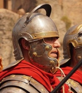 Close-up of a Roman soldier wearing a helmet